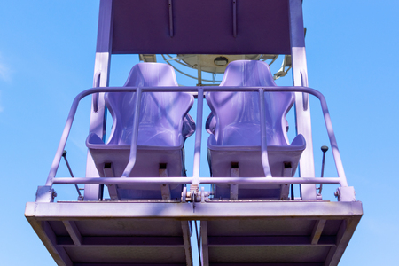 Free seats in the ferris wheel in the sky Stock Photo