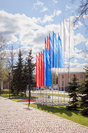 Flags in colors of Russian tricolor on May holidays