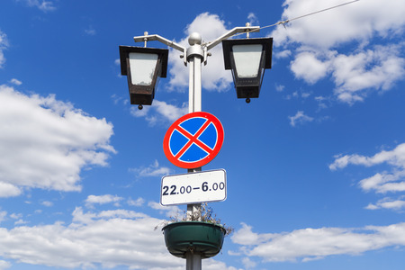 Road sign stop is on lamp post