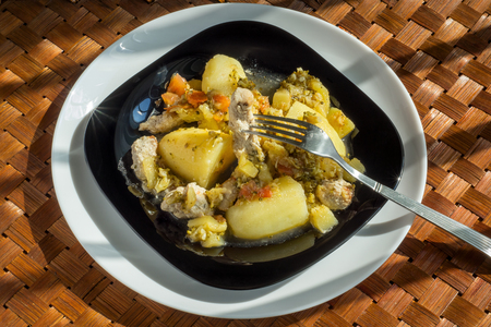 Pork with potatoes and vegetables Stock Photo