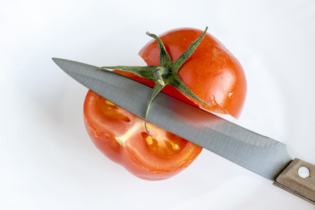 Knife and cut tomato