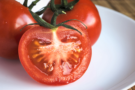 Tomatoes on plate close up Stock Photo
