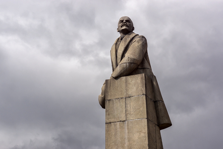 Granite monument of VI Lenin with a fur hat in his hand