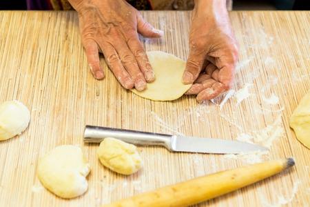 battledore: Making cabbage pies of dough Stock Photo