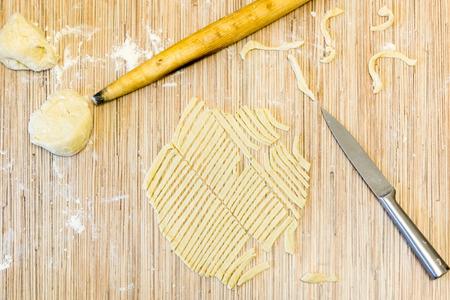 Cut the dough noodles top view Stock Photo