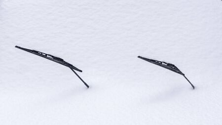 Car wipers stick out of a snowdrift Stock Photo