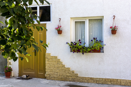 Home house facade decorated with natural flowers