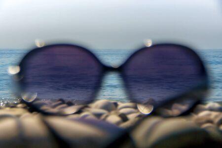 Sunglasses on pebble beach of the Black Sea