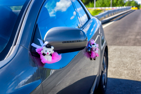 Sparkling clean car decorated with wedding bear toys