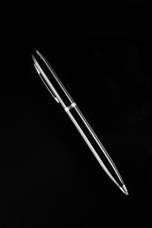 Black ballpoint pen on black background