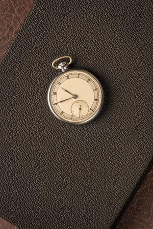 Pocket watch on dark textured background