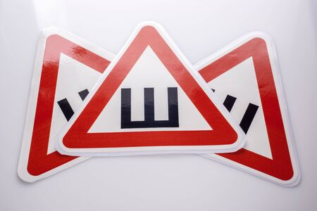 Sign spikes for vehicles with spikes on tires Stock Photo