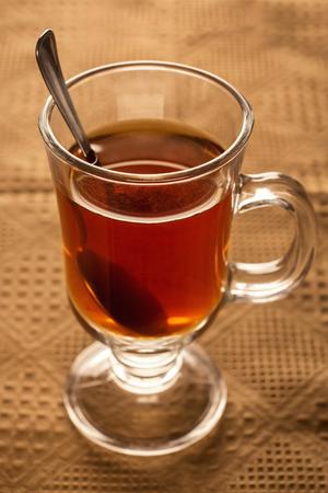 Cozy black tea cup on table