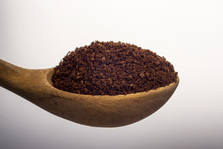 Full spoon of natural ground coffee