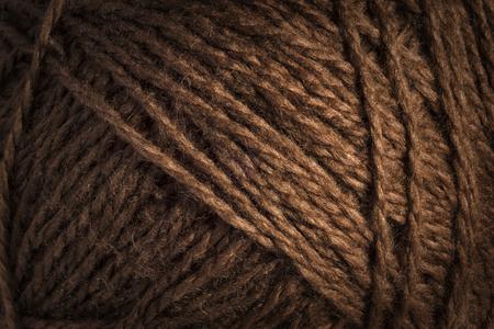 Warm brown wool threads background