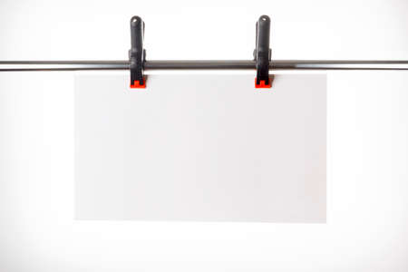 White plate hanging on pins Stock Photo