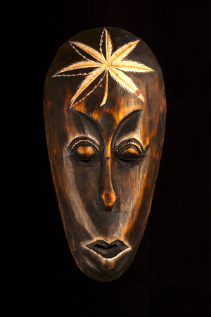 African wooden mask on black 版權商用圖片