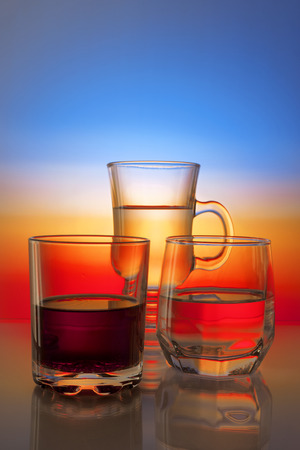 Glasses with drinks on a beautiful gradient background