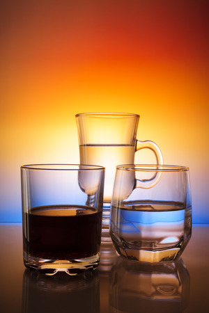 Glasses with beverages on a beautiful gradient background