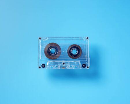 Vintage tape cassette on blue background