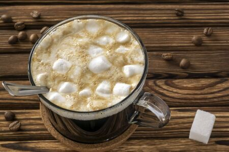 Morning cup of natural sweet coffee with milk and marshmallows Stock Photo