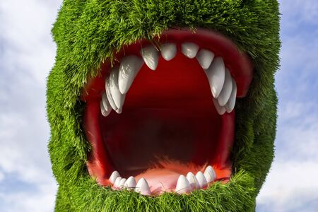 Dinosaur head with open mouth covered with artificial green grass