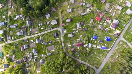 Aerial panorama of houses of Russian old summer cottage village in summer