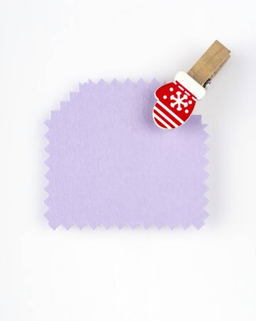 Lilac paper tag with a little christmas mitten pin