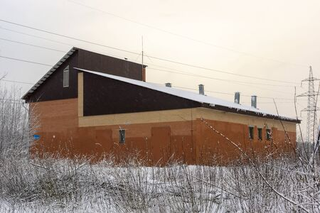 The building of the electrical substation in the city in winter Фото со стока