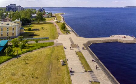 Tourists and citizens on city lake promenade in summer, aerial view Фото со стока