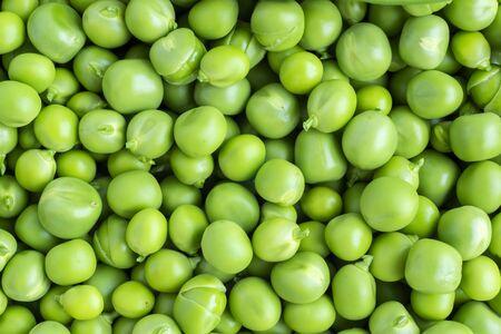Background of fresh natural organic vegetable food - green peas Фото со стока