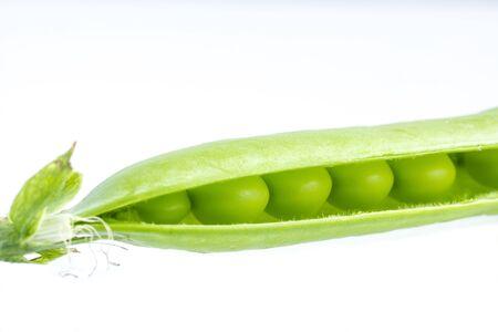 Opened green pea pod with peas is concept macro of organic food Фото со стока