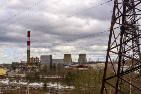 Industrial landscape of pipes of thermal power station and high-voltage mast