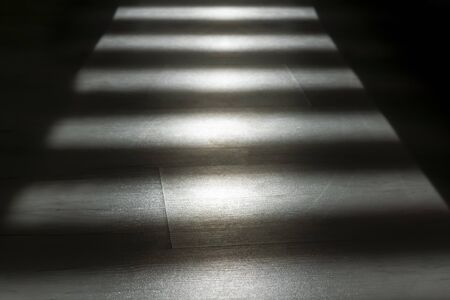 Geometry of streaks of lights and shadows in room, background Фото со стока