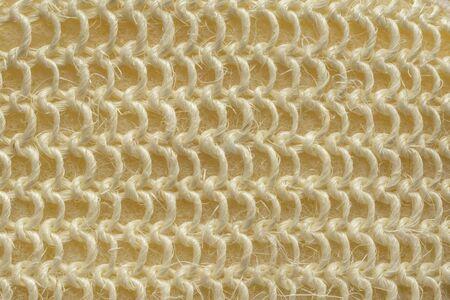Wonderful background of coarse woven fibers of bath sponge for body wash