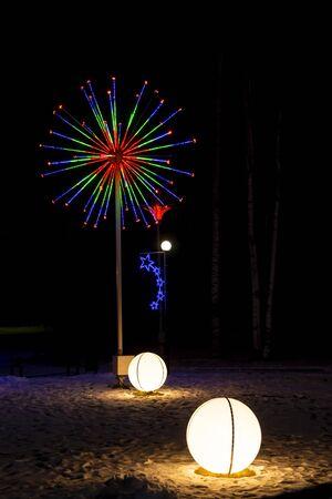 Wonderful holiday illuminated figures decorate night city at winter Фото со стока