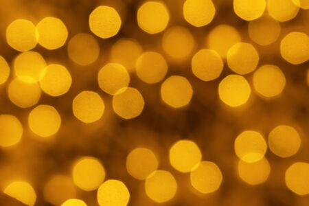 Holiday illumination of sparkling brown and yellow bokeh background