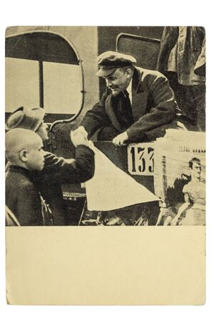 Lenin on Red Square in Moscow in 1919 says goodbye to people on parade, postcard Редакционное