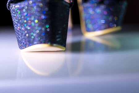 Sexy high heel shoes sparkle with colorful lovely glints in bokeh