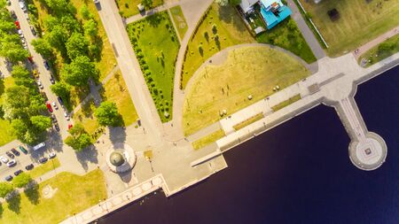 Aerial view of city lake promenade and green park in summer Фото со стока