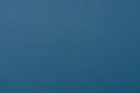 Wonderful blue color matte textured wall background Фото со стока