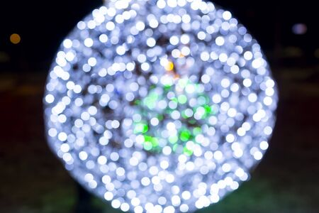 Spherical magic bokeh lights of sparkling holiday illumination at night