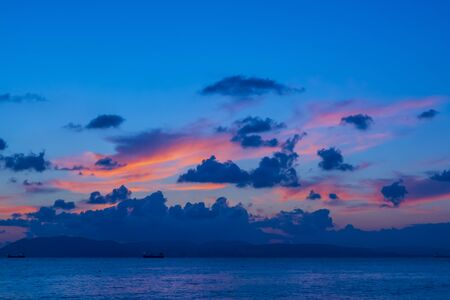 Glimpses of sunset on clouds in summer at night on the Black Sea in Gelendzhik
