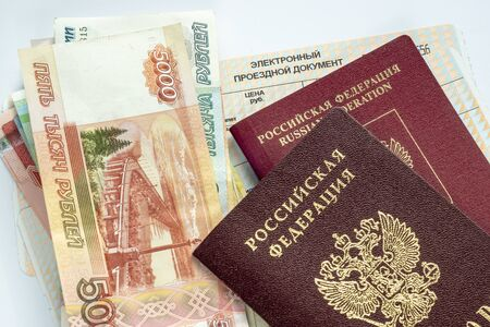 Ruble banknotes in cash and passports of Russian citizen are on train tickets