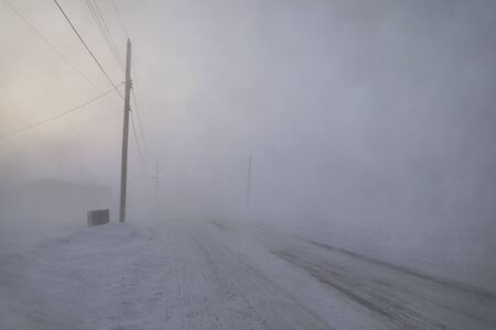 Road disappearing under blizzard conditions in Arviat, Nunavut Canada in winter conditions