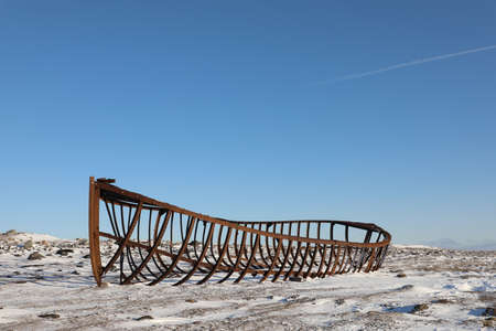 The steel hull of Arviat's iconic Hudson Bay Company supply boat, from 1923