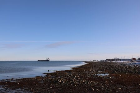 Resupply cargo barge on the waters of Nunavut near the community of Arviat in the Kivalliq Region