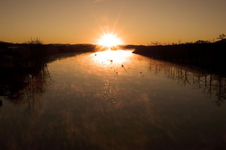 december sunrise: December sunrise over a river in the Texas hill county Stock Photo