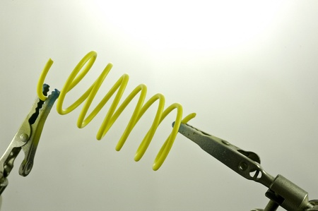 Clamps holding a coiled spring