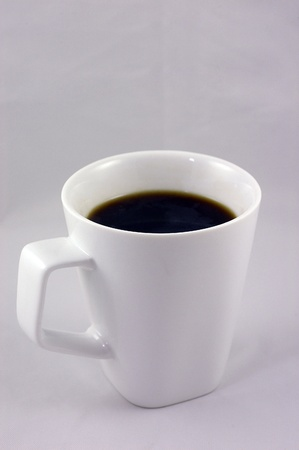 Hot cup of  coffee in white cup